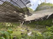 The damage done to the Arecibo Observatory by a broken cable that supported a metal platform, creating a 100-foot gash to the radio telescope's reflector dish in Arecibo, Puerto Rico.