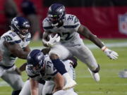 Seattle Seahawks running back Chris Carson (32) runs against the Arizona Cardinals during the first half of an NFL football game, Sunday, Oct. 25, 2020, in Glendale, Ariz. (AP Photo/Ross D.