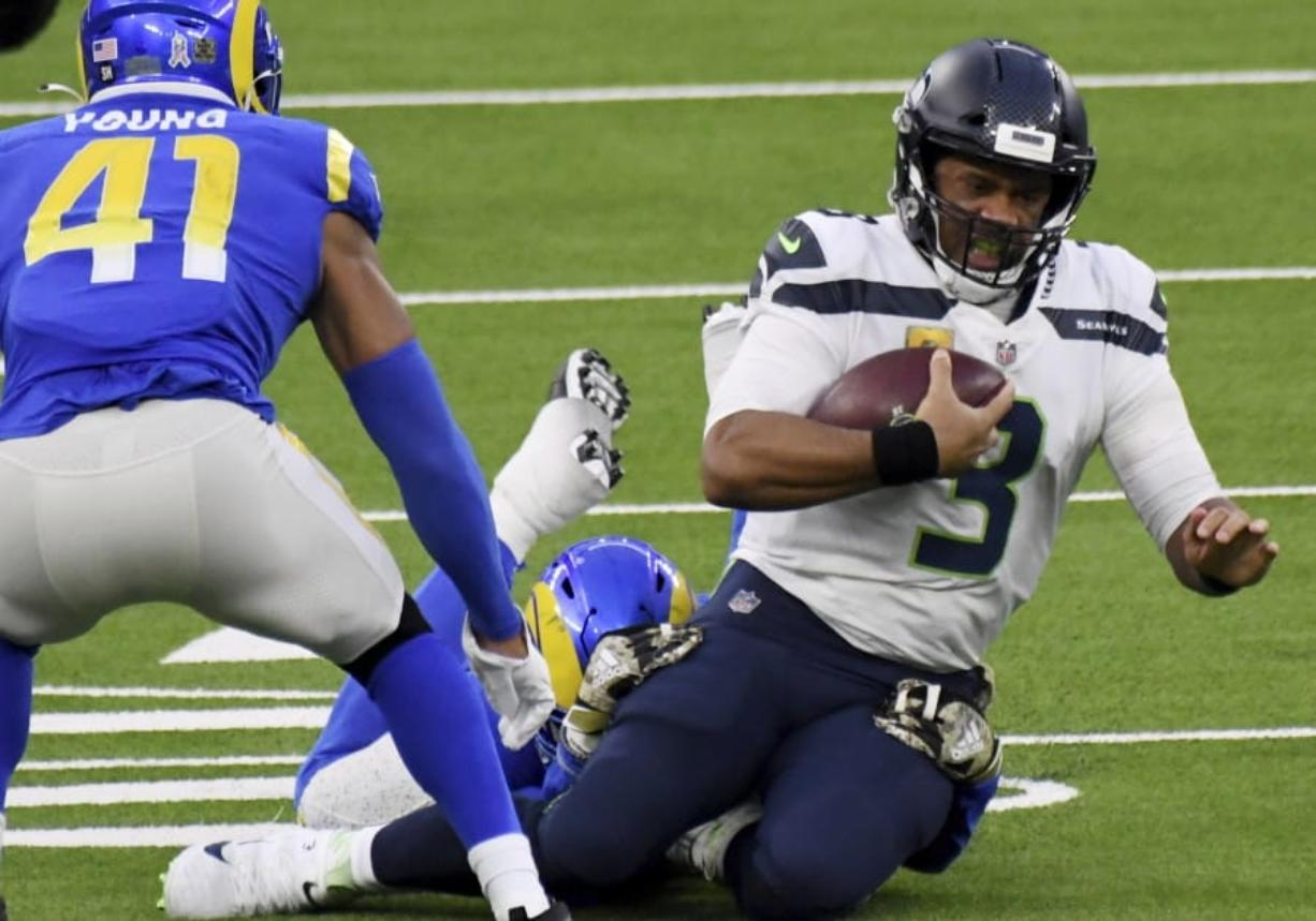 Seattle Seahawks quarterback Russell Wilson (3) scrambles against the Los Angeles Rams in the fourth quarter of an NFL football game in Inglewood, Calif., Sunday, Nov. 15, 2020.