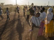 Tigray refugees who fled a conflict in the Ethiopia's Tigray region run at Village 8, the transit centre near the Lugdi border crossing, eastern Sudan on Sunday.