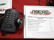 A playbook sits next to a telephone Dec. 23 in the NORAD Tracks Santa center at Peterson Air Force Base in Colorado Springs, Colo.