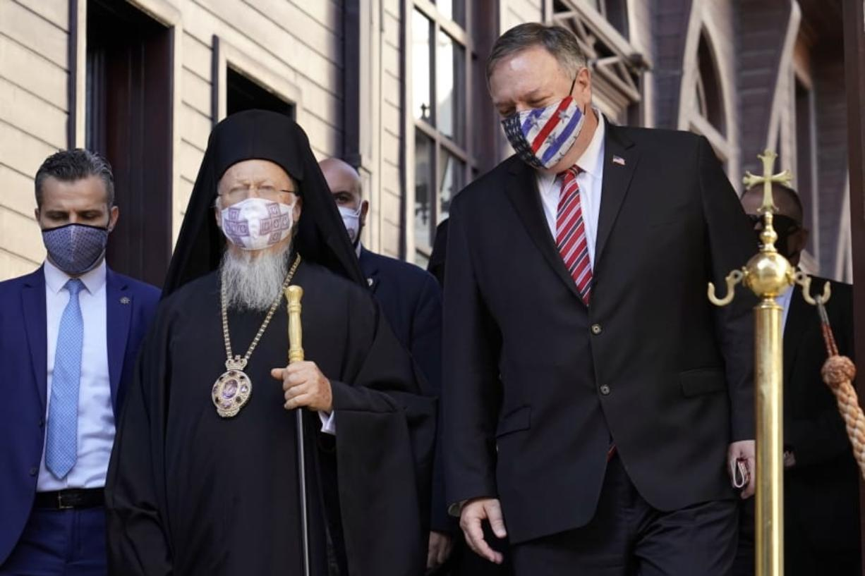 Secretary of State Mike Pompeo, right, speaks with Ecumenical Patriarch Bartholomew I, the spiritual leader of the world's Orthodox Christians, before departing the Patriarchal Church of St. George in Istanbul, Tuesday, Nov. 17, 2020. Pompeo's stop in Turkey is focused on promoting religious freedom and fighting religious persecution, which is a key priority for the U.S. administration, officials said.