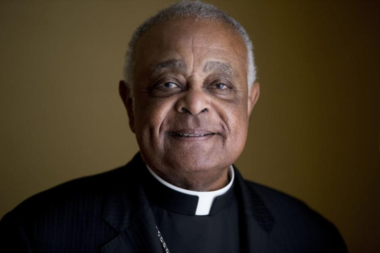 FILE - This Sunday, June 2, 2019, file photo shows Washington D.C. Archbishop Wilton Gregory posed for a portrait following mass at St. Augustine Church in Washington. Gregory, who is undergoing quarantine at the Santa Marta hotel before Saturday's consistory, said that while he was unable to go out, at least he was able to get his new red cassock delivered from Rome'Aos famous clerical haberdasher, Gammarelli.