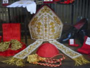 Cardinal clothing accessories are seen on display in the window of the Gammarelli clerical clothing shop, in Rome, Thursday, Nov. 26, 2020. The consistory to elevate new cardinals scheduled for Saturday, Nov. 28, in the time of coronavirus is like nothing the Holy See has ever seen. A handful of soon-to-be cardinals are in protective coronavirus quarantine, including African-American, Cardinal-designate Wilton Gregory, archbishop of Washington who explained that a U.S.-based ecclesiastical tailor took his measurements while he was still in Washington and sent them to Gammarelli, which then made them to order and sent them to Santa Marta hotel where he is undergoing the quarantine.