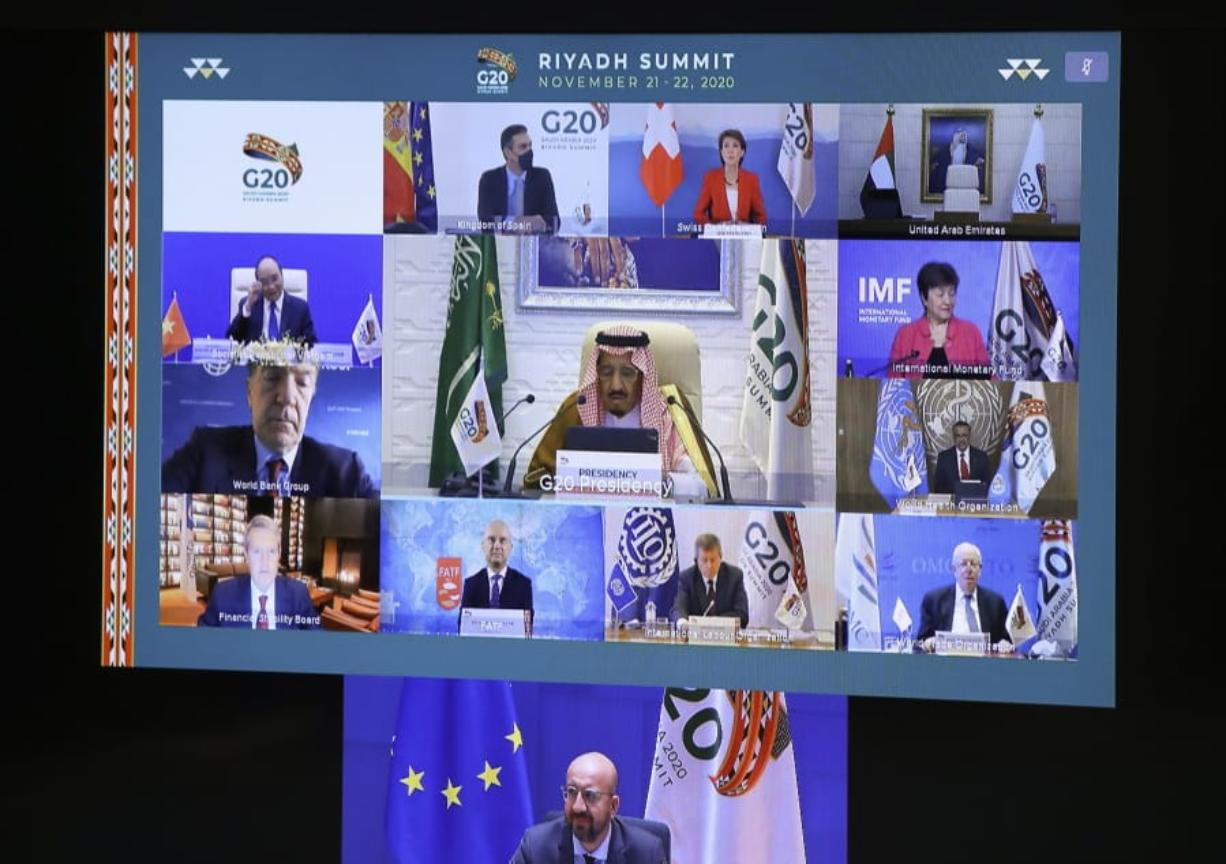 European Council President Charles Michel, on screen bottom, participates in a virtual G20 meeting, hosted by Saudi Arabia, at the European Council building in Brussels, Saturday, Nov. 21, 2020.