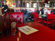 A Red Robin restaurant in Tigard, Ore., has closed some tables in order to maintain social distancing between diners per CDC guidelines in March. Much of Oregon is under a new round of restrictions.