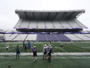 Washington players and coaches take part in NCAA college football practice, Friday, Oct. 16, 2020, at Husky Stadium in Seattle. (AP Photo/Ted S.