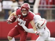 FILE - In this Nov. 16, 2019, file photo, Washington State running back Max Borghi, left, carries the ball during the first half of an NCAA college football game in Pullman, Wash. Borghi is likely to get more rushing attempts under the new Washington coach Nick Rolovich.