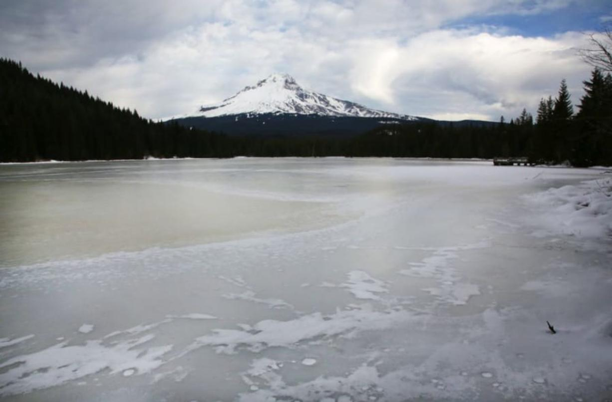 Mount Hood rises over an icy Trillium Lake in the Mount Hood National Forest.