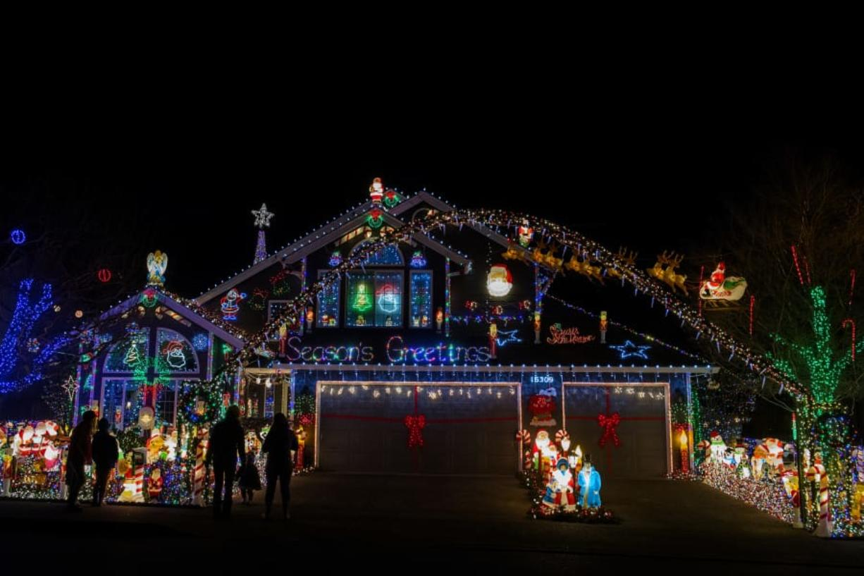 At the Buchanan home at 15309 N.E. 7th St., Vancouver, thousands of colorful lights illuminate the night sky.