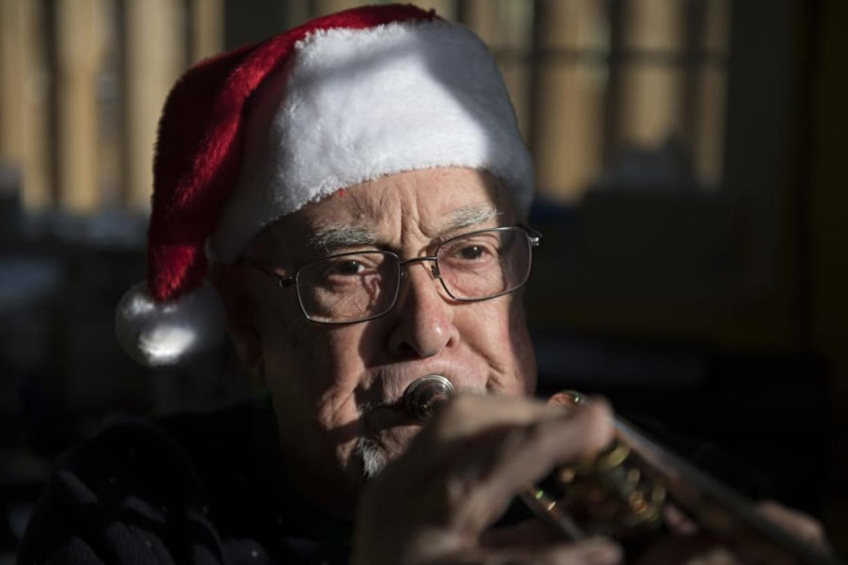Former Fort Vancouver High School band director Ray B. Johnson plays a trumpet in his home music studio. Johnson is trying to find members of his 1977 stage band to share a CD made on their last day of class with all sorts of classic big band tunes.