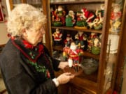 Joanna Hamnes, 79, talks about her Norwegian-style Santa figurine. Her collection includes Santas in costumes from around the world.