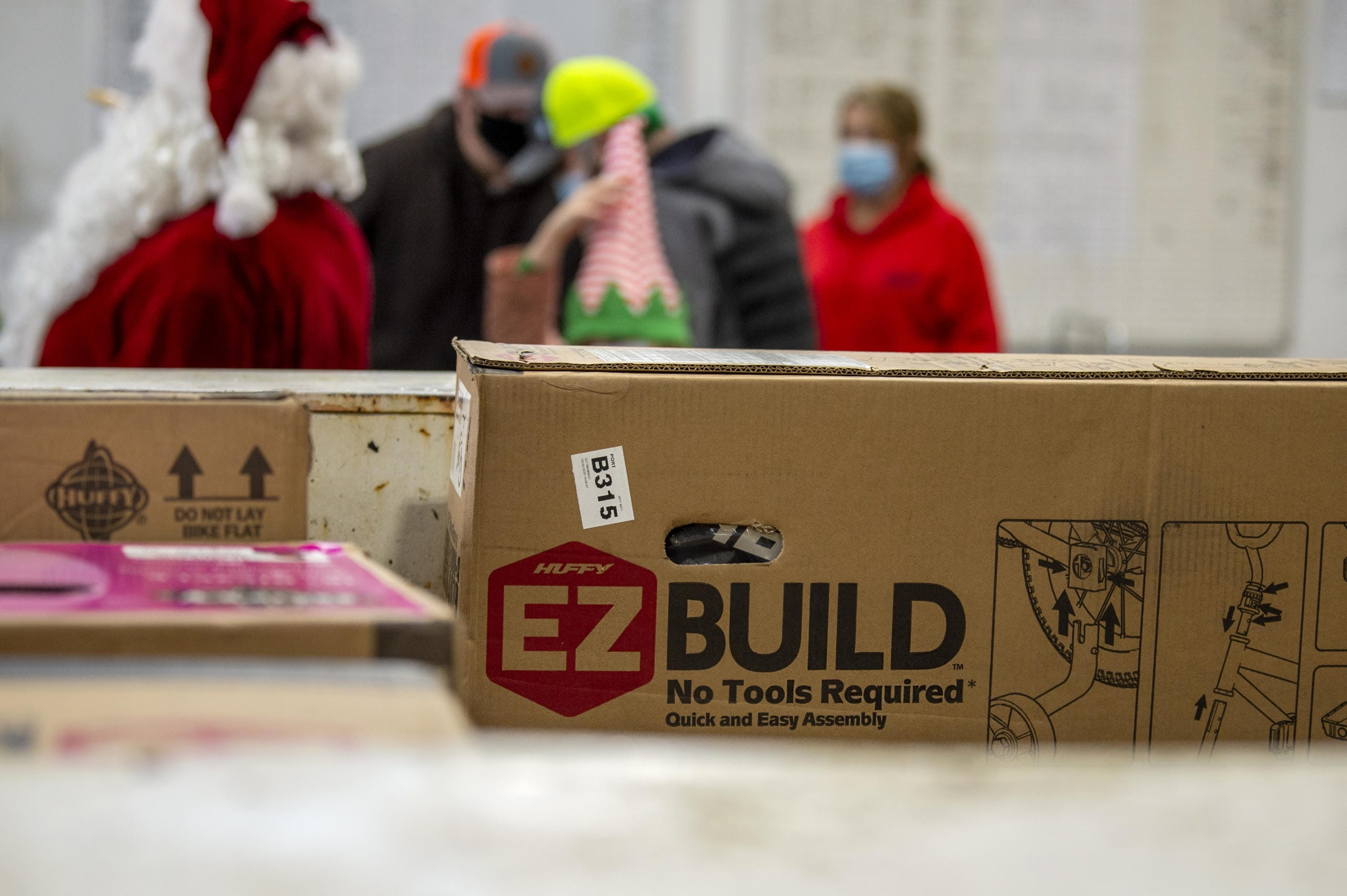 Volunteers were given several boxes of bicycle parts that they will later build on Saturday, December 12, 2020, at Taylor Transport in Vancouver. Volunteers picked up the parts to bicycles as part of the Scott Campbell Christmas Promise. (Joshua Hart/The Columbian)