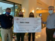 CAMAS: The Clark County Sheriff's Office Santa's Posse effort received a $15,470 donation on Dec. 11 from The Camas-Washougal Rotary Club and WaferTech to go toward toys and food that will be distributed to 1,200 families in Clark County.