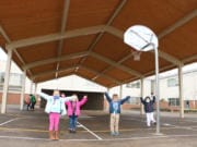 BATTLE GROUND: Kindergartners at Maple Grove Primary School under the new covered play structure.