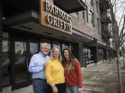 Rob Griffin, from left, and his wife, Deborah Barnard, pause for a portrait with their daughter, Megan Hughes, outside the new Barnard Griffin tasting room at The Waterfront Vancouver.