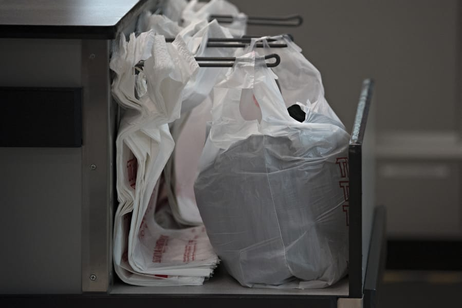 Goodwill and other retailers who use plastic bags will need to switch to paper bags or multi-use bags with thicker plastic under a new law that was previously scheduled to take effect Jan. 1.