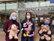 SALMON CREEK: Shirley Gross, left, and Dana Hughes, center, of Legacy Salmon Creek, and Susanne Holmberg, of Rotary Club of Three Creeks, unload new stuffed animals for children at Legacy Salmon Creek Medical Center.