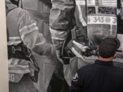 SALMON CREEK: Capt. Clint Greeley at Clark County Fire District 6 created a mural at the new station representing the difficult nature of the job as well as to honor victims in the Sept.