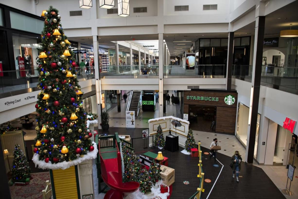 A colorful Christmas tree adds a festive touch for shoppers and workers at Vancouver Mall. Despite COVID-19 occupancy restrictions, general manager Tracy Peters said, the mall has done relatively well during the current holiday shopping season.