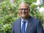 Washington Gov. Jay Inslee poses for a photo, Friday, Sept. 25, 2020, in Olympia, Wash.  (AP Photo/Ted S.