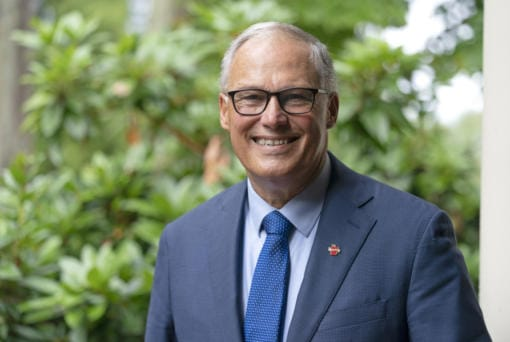 Washington Gov. Jay Inslee poses for a photo, Friday, Sept. 25, 2020, in Olympia, Wash. Inslee, a Democrat, is being challenged by Republican Loren Culp, police chief of the small town of Republic, Wash., in the Nov. 3 election. (AP Photo/Ted S.