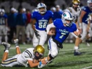 A Kelso defender brings down Mountain View quarterback Riley McCarthy during a game at McKenzie Stadium on Friday night, Oct. 25, 2019.