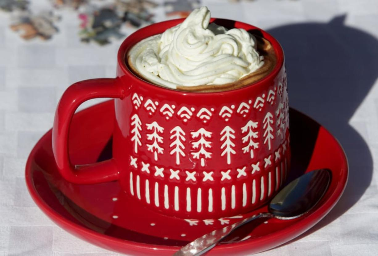 Hot chocolate, like this Parisian Hot Chocolate, is topped with Chantilly cream. (Photos by Hillary Levin/St.