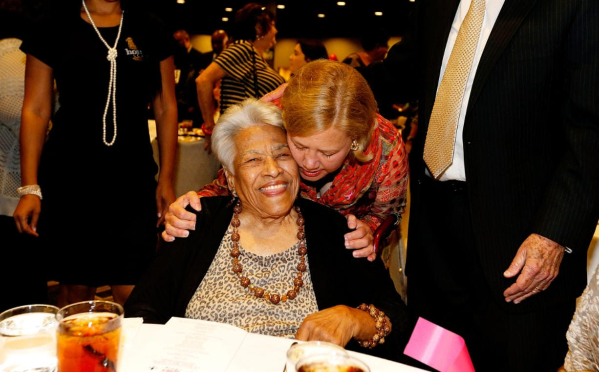 "U.S. Sen. Mary Landrieu, D-La., hugs chef Leah Chase during a ""Women with Mary"" campaign event on Oct. 22, 2014, in New Orleans."