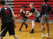 Fort Vancouver's Kahlil Singleton, center, at a practice back in January, found other teams to play with in other states during Washington's pandemic shut down of high school sports.