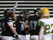 Hockinson's Sawyer Racanelli (9) celebrates a touchdown during the 2A state football championship game against Lynden on Saturday, Dec. 1, 2018, in Tacoma, Wash.