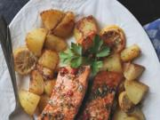 Salmon marinated in a spicy-sweet mix of brown sugar, soy sauce, ginger and chili is roasted along with potatoes for a quick and healthy dinner.