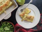 Crepe-like phyllo rolls are stuffed with a mixture of apples, shredded cheese, spinach, and ham, then topped with beaten eggs.