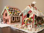 Two completed gingerbread houses. Ours is on the right and our roommates' is on the left.