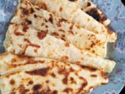Charles Schrag of Seattle has been making the traditional Norwegian food lefse since he was young. Schrag shows off his lefse, which is similar to a flatbread, made with potatoes near his Seattle-area home Dec. 7, 2020.