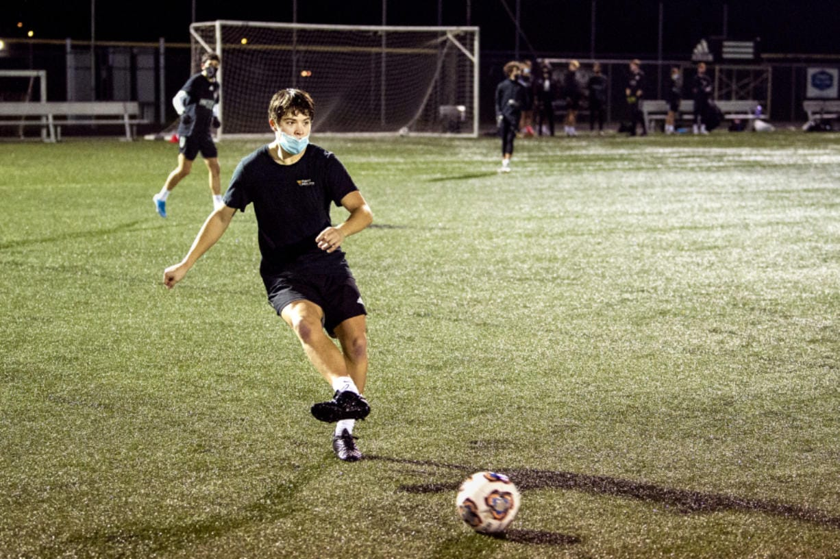 Ridgefield senior Steven Cunningham makes a pass during a Washington Timbers practice on Tuesday, December 22, 2020, at Harmony Sports Complex. Cunningham recently signed with the University of Providence to play soccer.