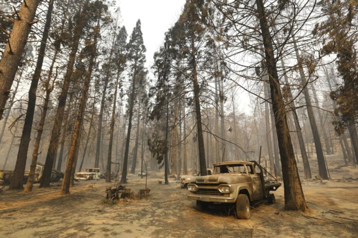 Several burnt vehicles and charred tree trunks are whatCfUs left of a homestead in Berry Creek after the North Complex fire in September.