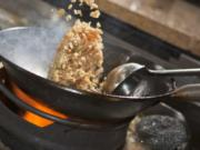 Cook Crabmeat Fried Rice in a flat-bottomed wok pan.
