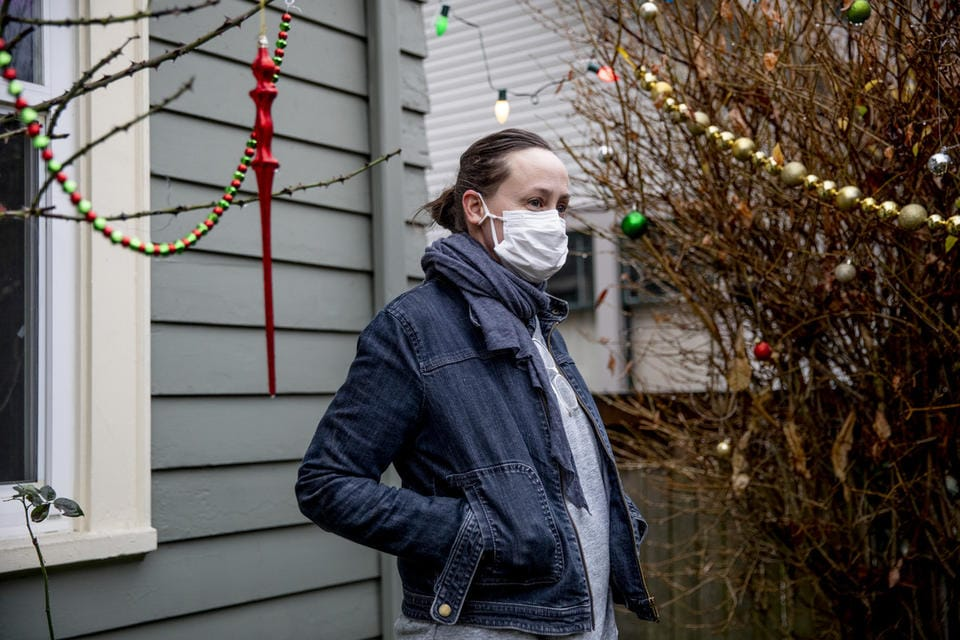 Heather Frey outside of her Seattle home on Dec. 15, 2020. Frey has been filing for pandemic unemployment assistance since March and, as of earlier this week, hadn't received a single payment yet.