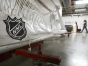 The National Hockey League and players reached a tentative deal Friday, Dec. 18, 2020, to hold a 56-game season in 2021, pending the approval of each side's executive board and Canadian health officials.