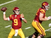 Quarterback Kedon Slovis #9 of the USC Trojans passes against Arizona State Sun Devils in the first half of a NCAA football game at the Los Angeles Memorial Coliseum in Los Angeles on Saturday, November 7, 2020.
