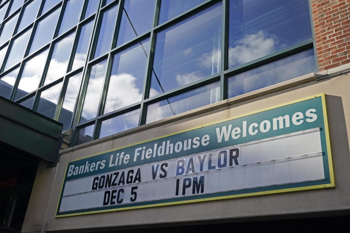A sign outside of Bankers Life Fieldhouse shows the display for the Gonzaga vs. Baylor basketball game that was scheduled to play in an NCAA college basketball game, Saturday, Dec. 5, 2020, in Indianapolis. The game was canceled due to COVID.