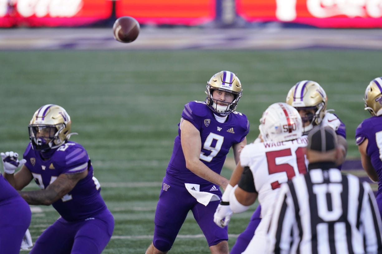 Washington quarterback Dylan Morris (9) throws against Stanford in the first half of an NCAA college football game Saturday, Dec. 5, 2020, in Seattle.