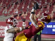 Southern California wide receiver Amon-Ra St. Brown, right, catches a touchdown over Washington State defensive back Armani Marsh during the first half of an NCAA college football game in Los Angeles, Sunday, Dec. 6, 2020.