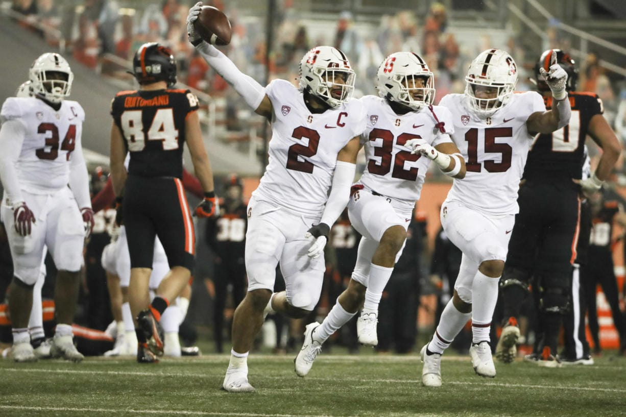 Stanford's Curtis Robinson (2), Jonathan McGill (32) and Stephen Herron (15) celebrate Robinson's recovery of an Oregon State fumble during the last minute of the second half in an NCAA college football game in Corvallis, Ore., Saturday, Dec. 12, 2020. Stanford won 27-24.