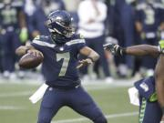 Seattle Seahawks quarterback Geno Smith drops back to pass against the New York Jets during the second half of an NFL football game, Sunday, Dec. 13, 2020, in Seattle.