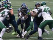 Seattle Seahawks running back Chris Carson runs the ball during the second half of an NFL football game against the New York Jets, Sunday, Dec. 13, 2020, in Seattle. The Seahawks won 40-3.