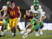 Oregon quarterback Tyler Shough (12) runs the ball during the second half of an NCAA college football game for the Pac-12 Conference championship against Southern California Friday, Dec 18, 2020, in Los Angeles.