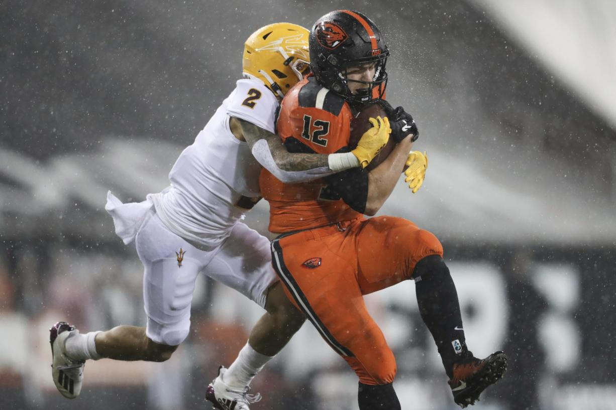 Oregon State inside linebacker Jack Colletto (12), a Camas High grad, is brought down by Arizona State defensive back DeAndre Pierce (2) during the first half of an NCAA college football game in Corvallis, Ore., Saturday, Dec. 19, 2020.