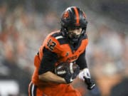 Oregon State inside linebacker Jack Colletto (12) rushes for a touchdown during the second half of an NCAA college football game against Arizona State in Corvallis, Ore., Saturday, Dec. 19, 2020. Arizona State won 46-33.